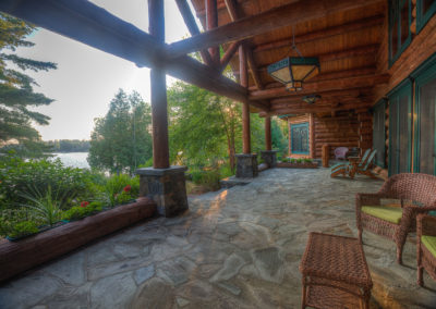 Covered porches overlook the lake.