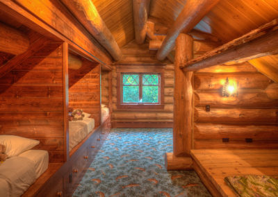 Adirondack bunk room complete with an indoor lean-to.
